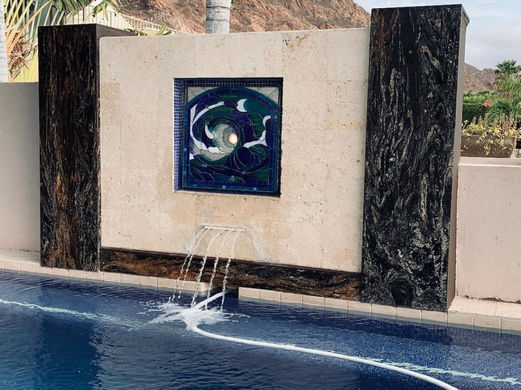 Pool Side Water Feature Filled In With A Cresting Wave Stained Glass Panel