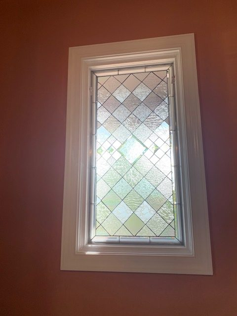 Multiple Beautiful Beveled All Clear Leaded Windows Installed In A Living Room