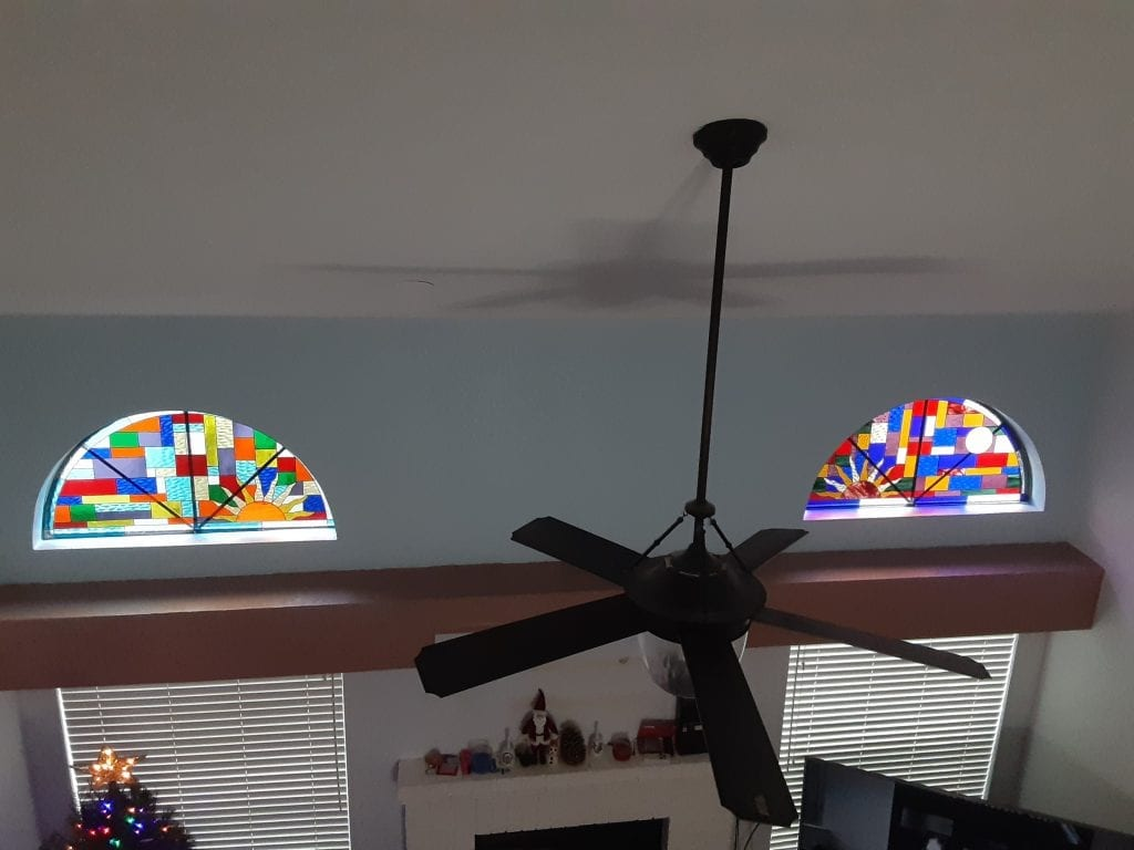 Stained Glass Window Inserts above Fireplace Windows