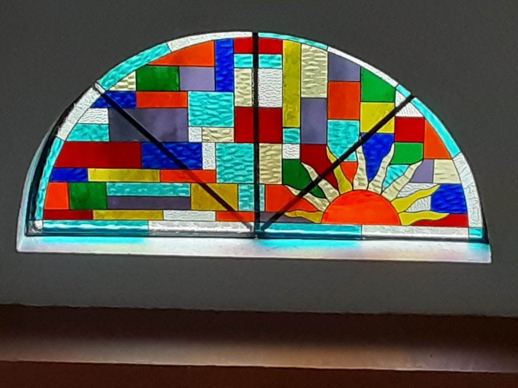 Arched colorful sun setting Stained Glass Insert Installed