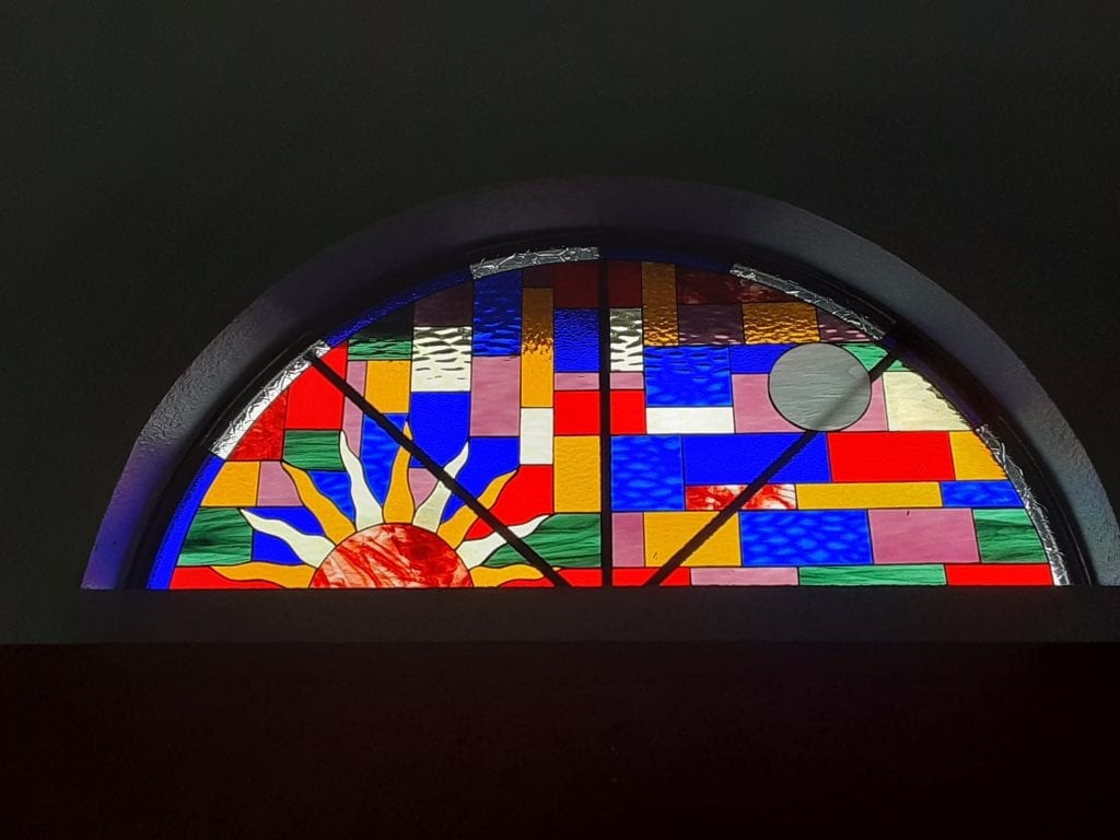Arched colorful sun setting Stained Glass