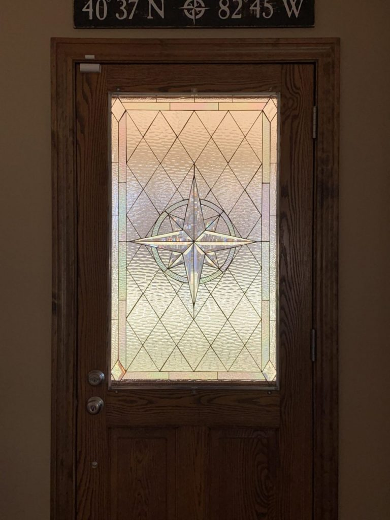 Stained Glass Beveled Compass Rose Installed In A Front Door