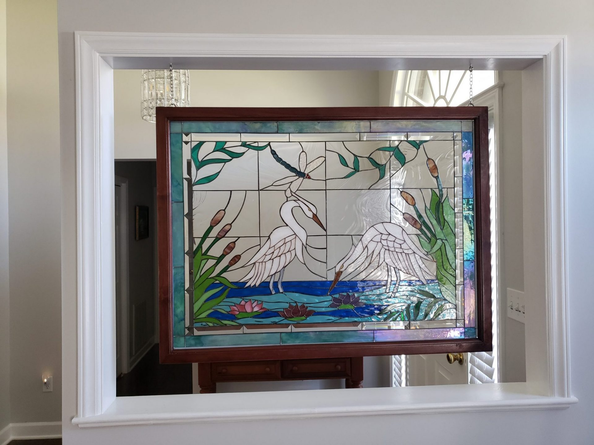 Heron design Stained Glass hang as a compliment to her entryway (after)