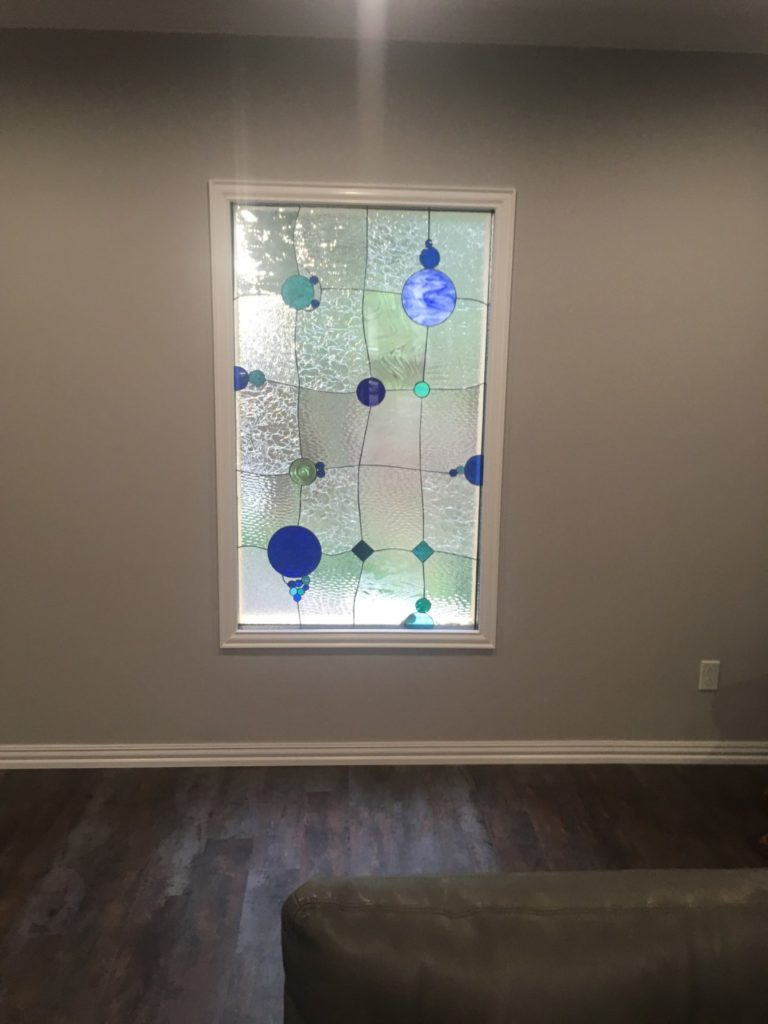 Triple paned stained glass bubbles design