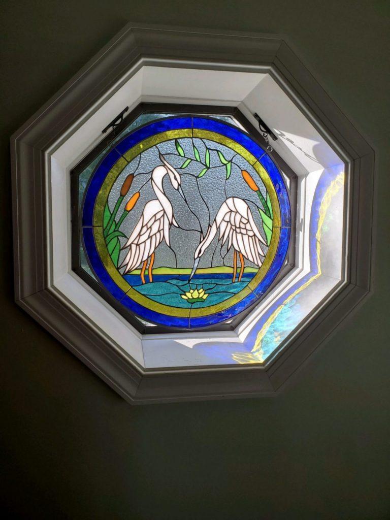 round heron window