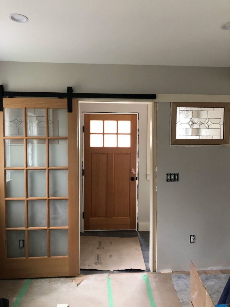 Single pane Stained Glass installed between two rooms.