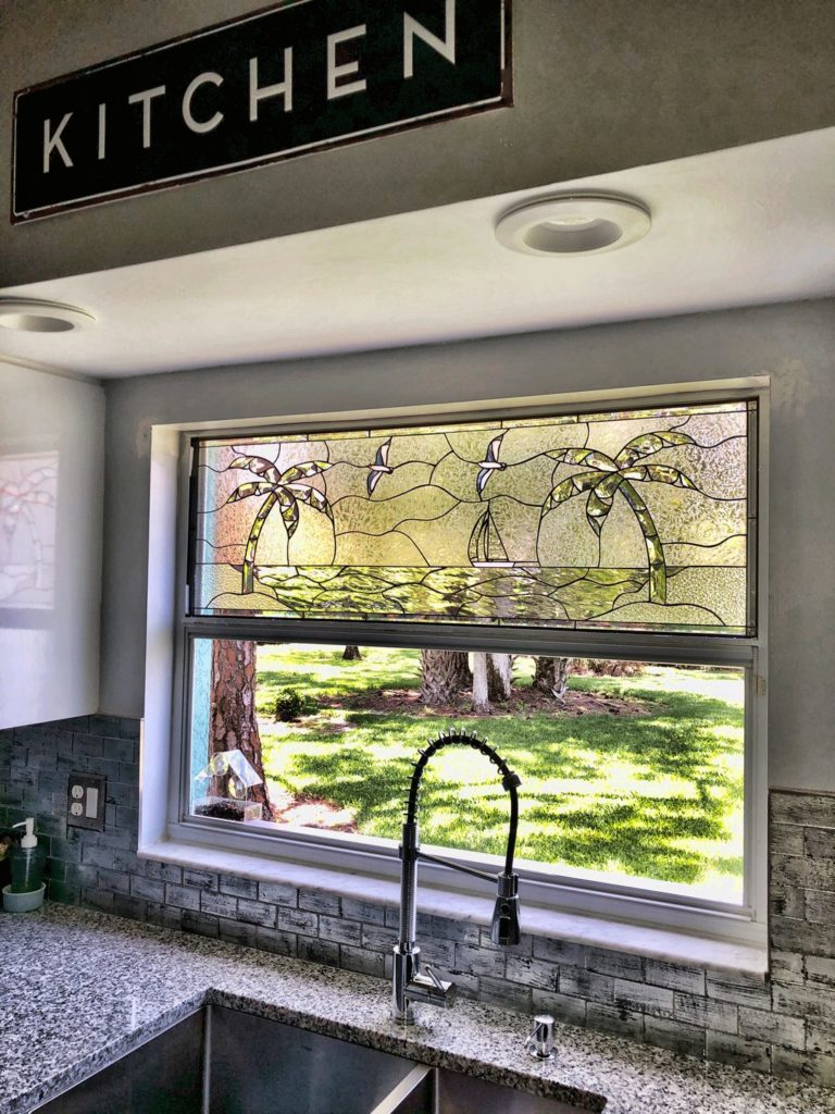 Beveled Palm Tree Beach & Sailboat Stained Glass installed in a Kitchen