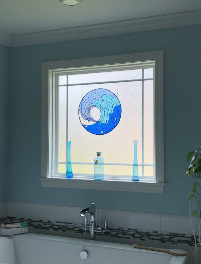 Blue Cresting Wave Design Stained Glass Installed over a bathtub