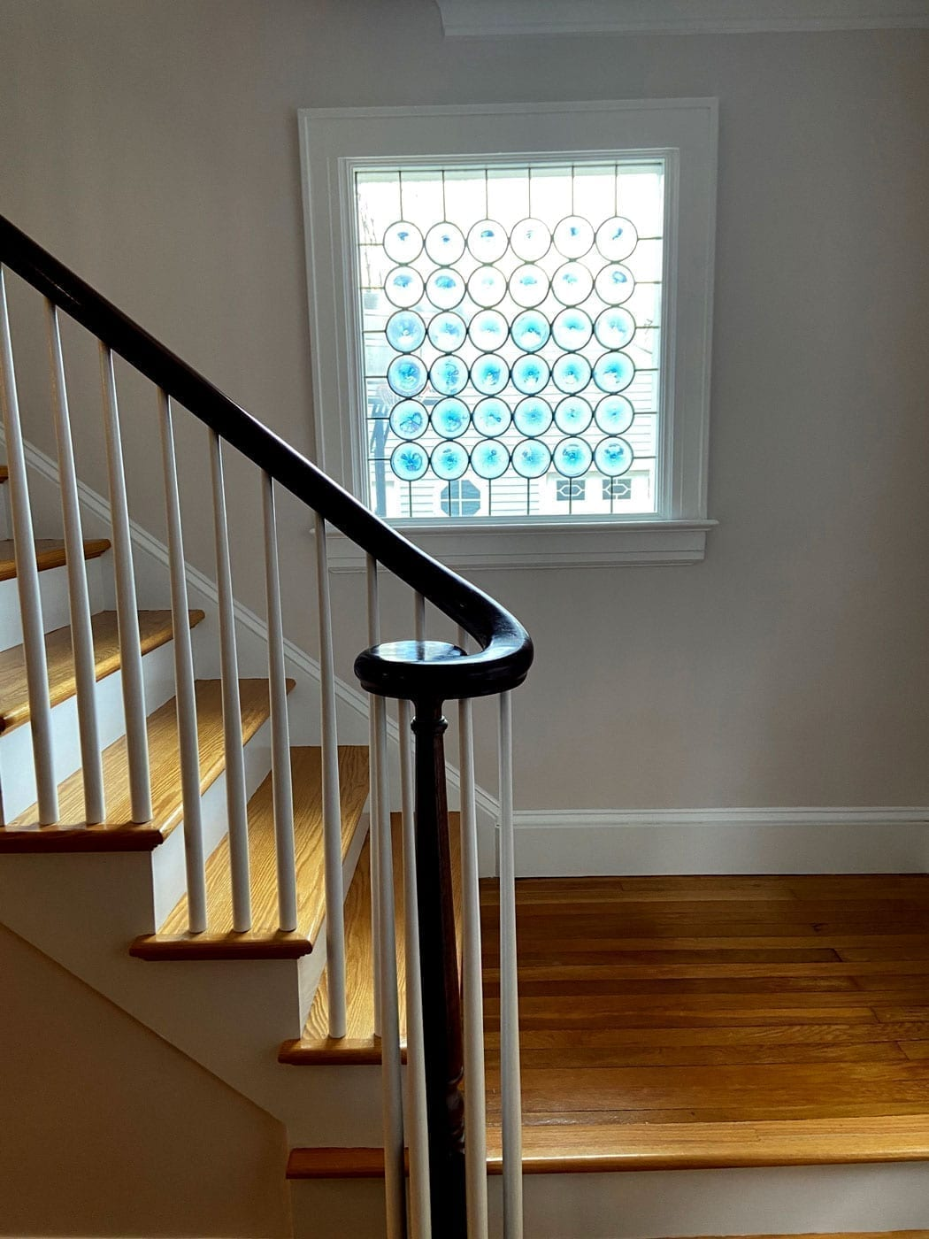 The Classic Rondel Stained Glass Installed on the living room