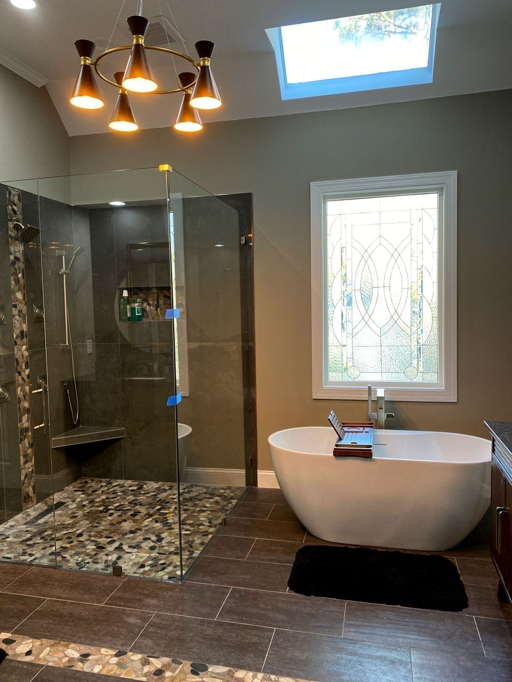 Stained glass framed installed over a bathtub