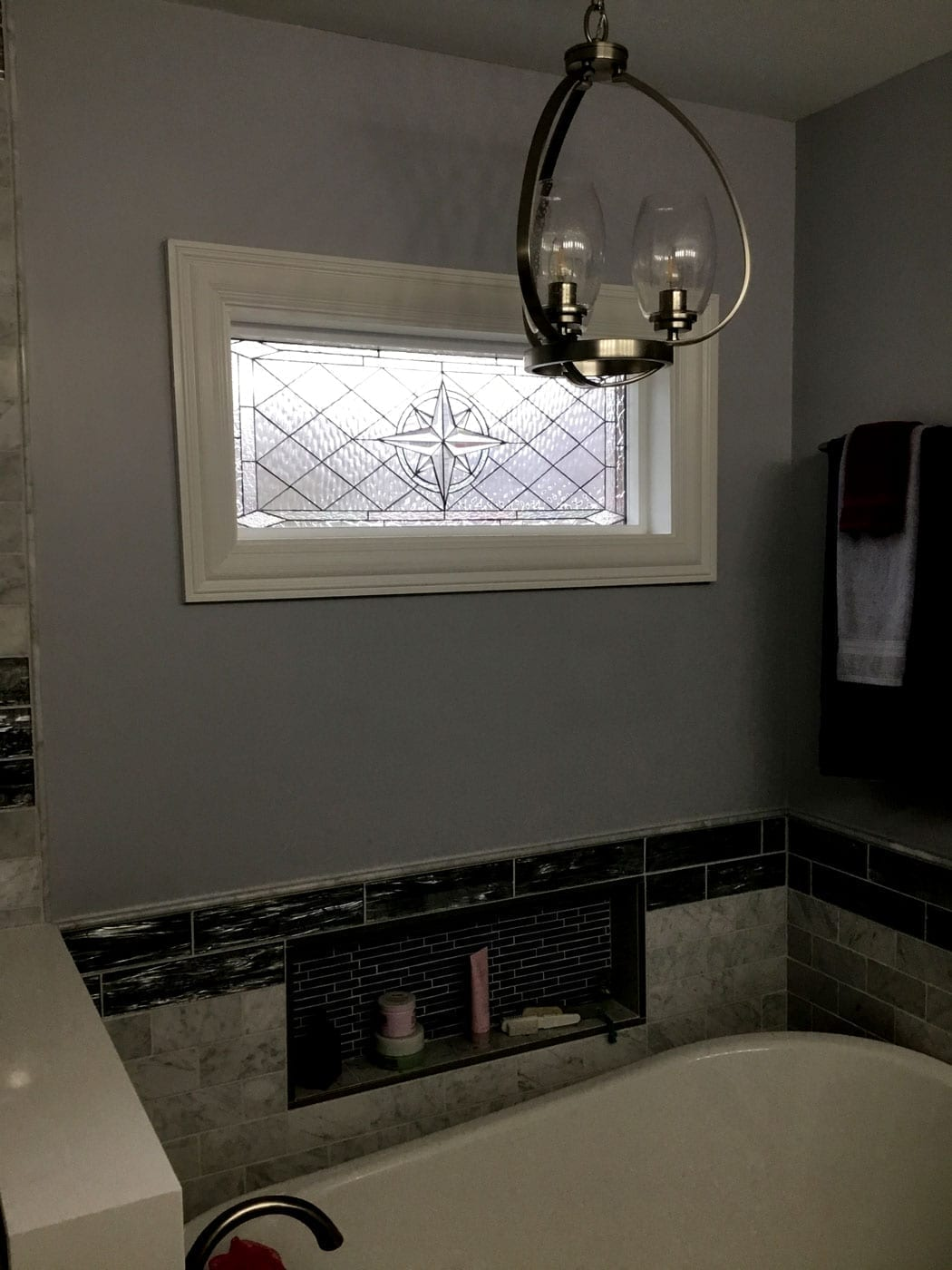 """The """"Maywood"""" Stained Glass Window installed over a bathtub"""