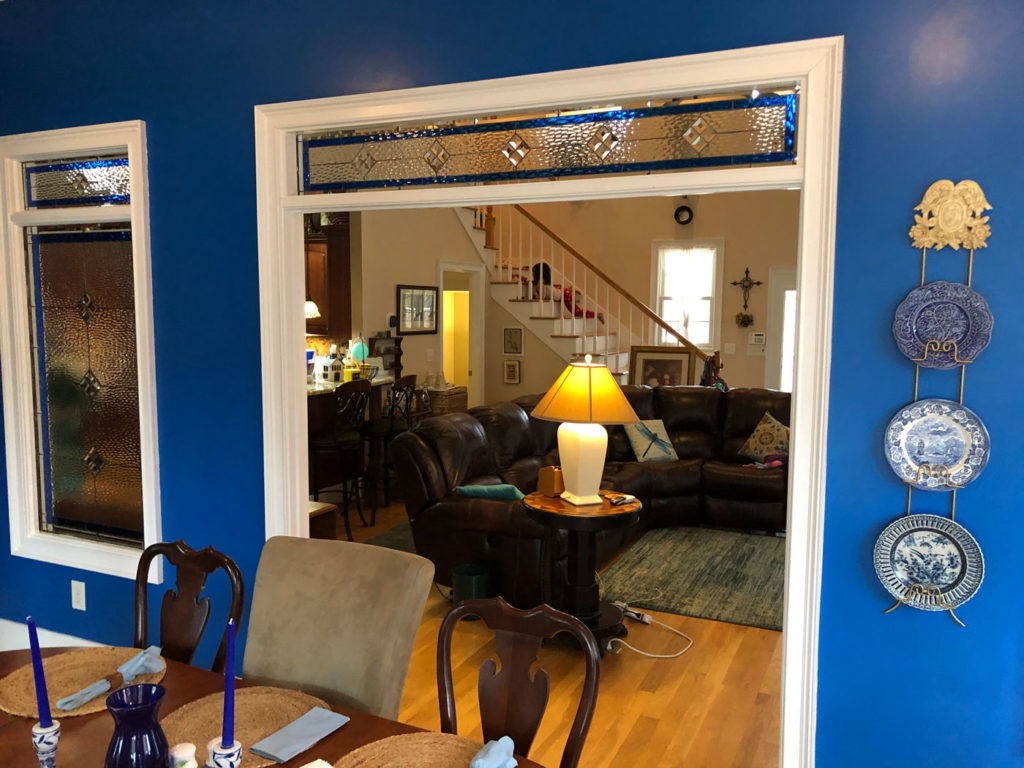 Single pane Stained Glass mounted between two rooms