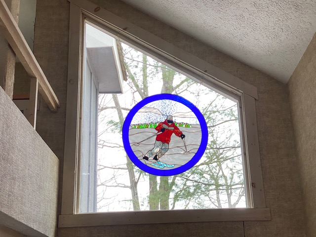 Hanging Stained Glass Window in a Ski Home