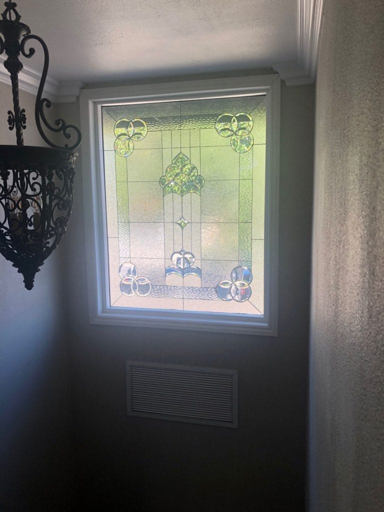Clear and Beveled Stained Glass Stairway Window