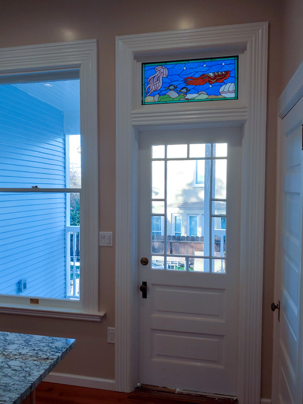 Undersea life stained glass transom window
