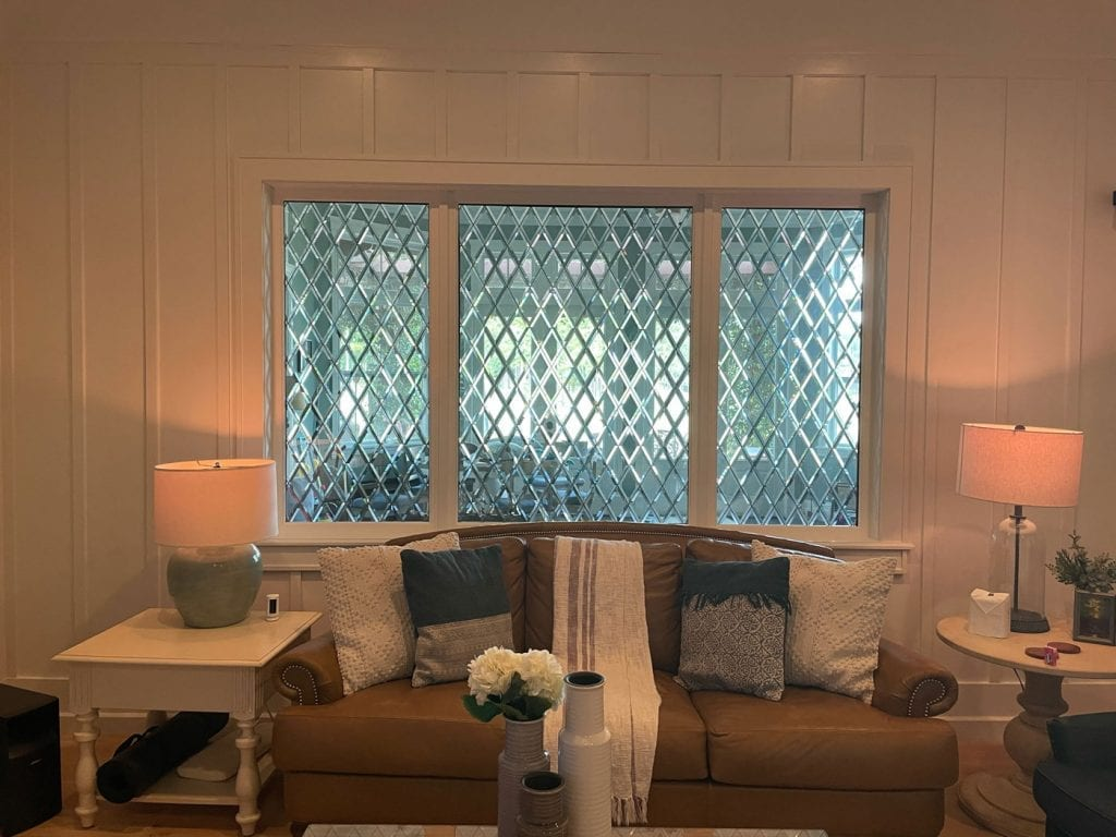 Classic Tudor Style Stained Glass Window Installed in a Living room