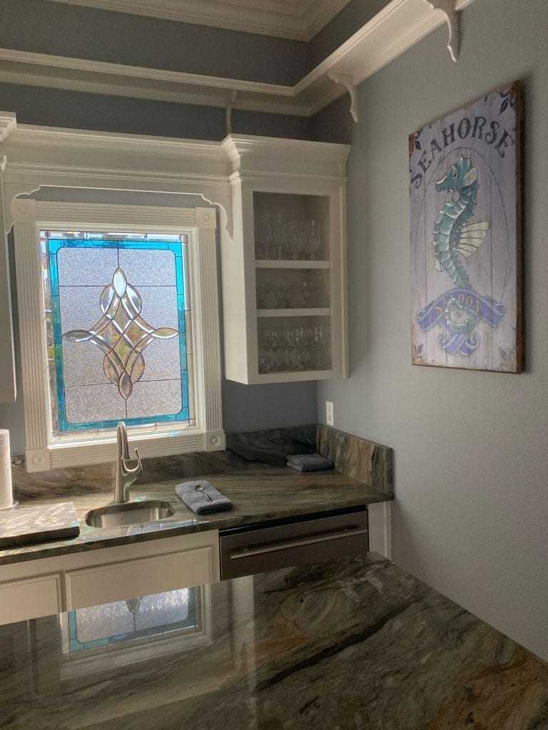 Clear Stained Glass Window with a touch of color installed over a Kitchen Sink