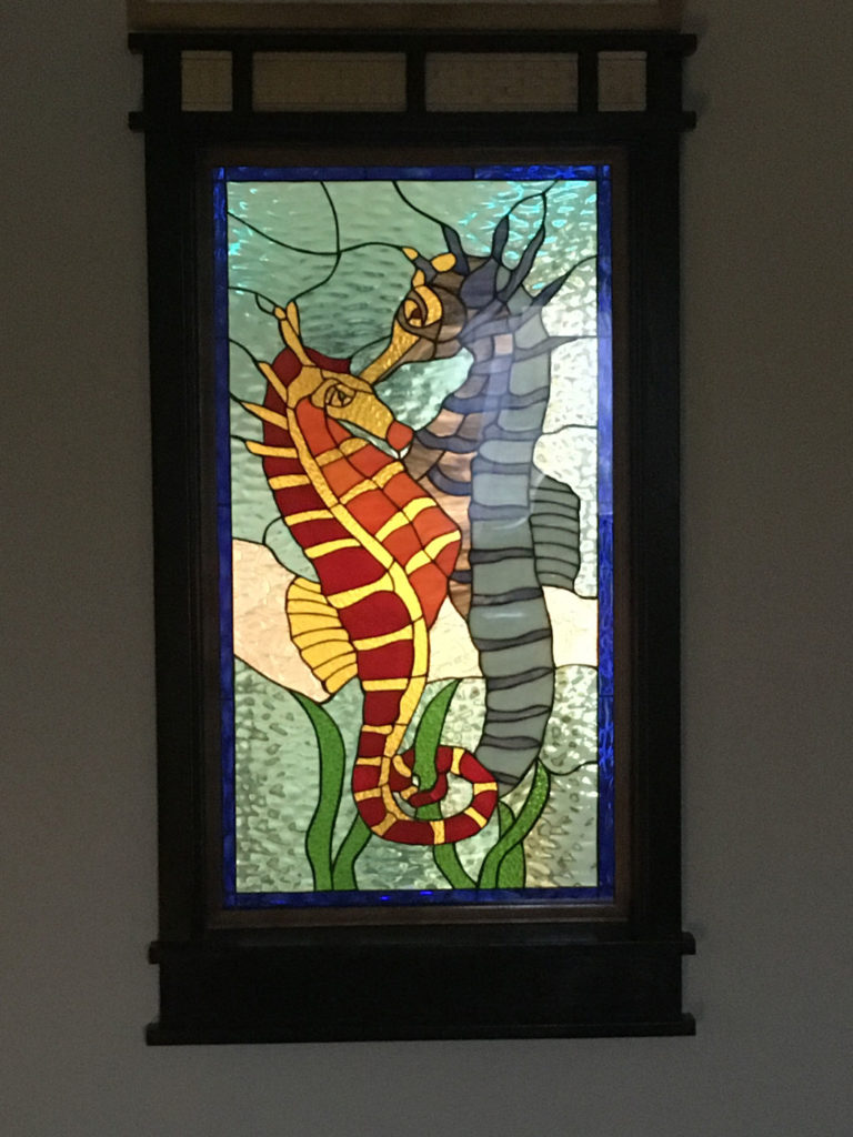 Stained Glass sealed within tempered glass , which customer framed in between two rooms.