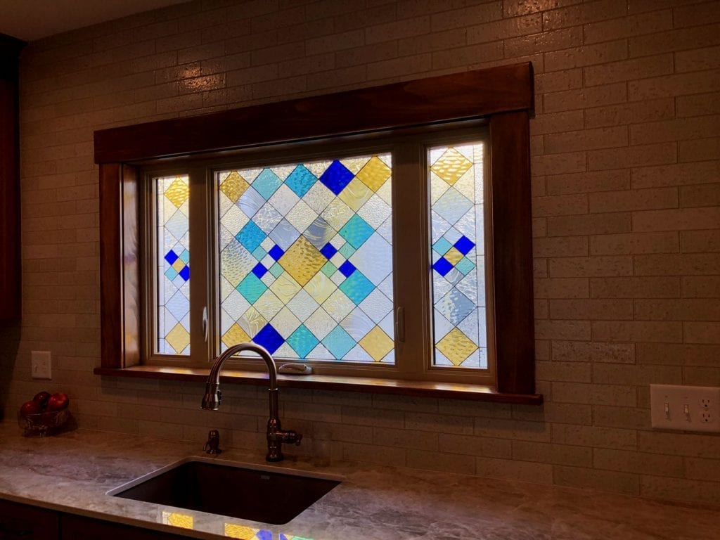 Beautiful Stained Glass installed over a Kitchen Sink