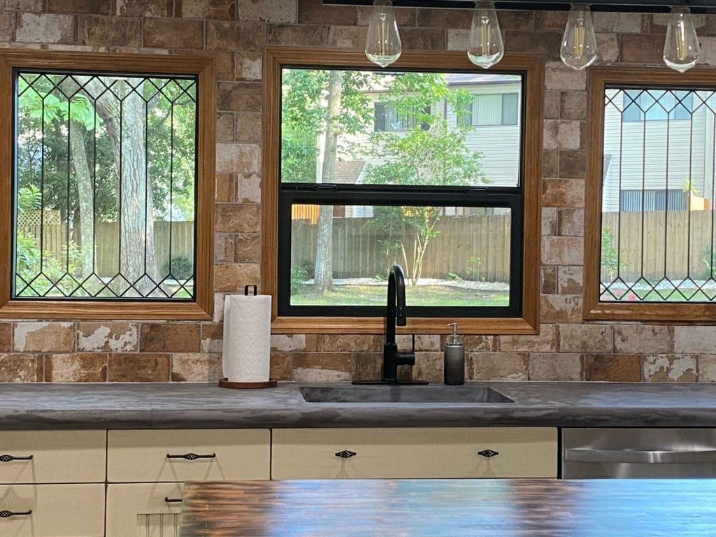 Classic Style trimmed in Stained Glass Windows Installed over a sink
