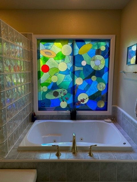 Coloful Stained Glass Panels Installed over a Bathtub