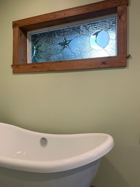 Clear Sun, Star and Moon Stained Glass installed over a Bathtub