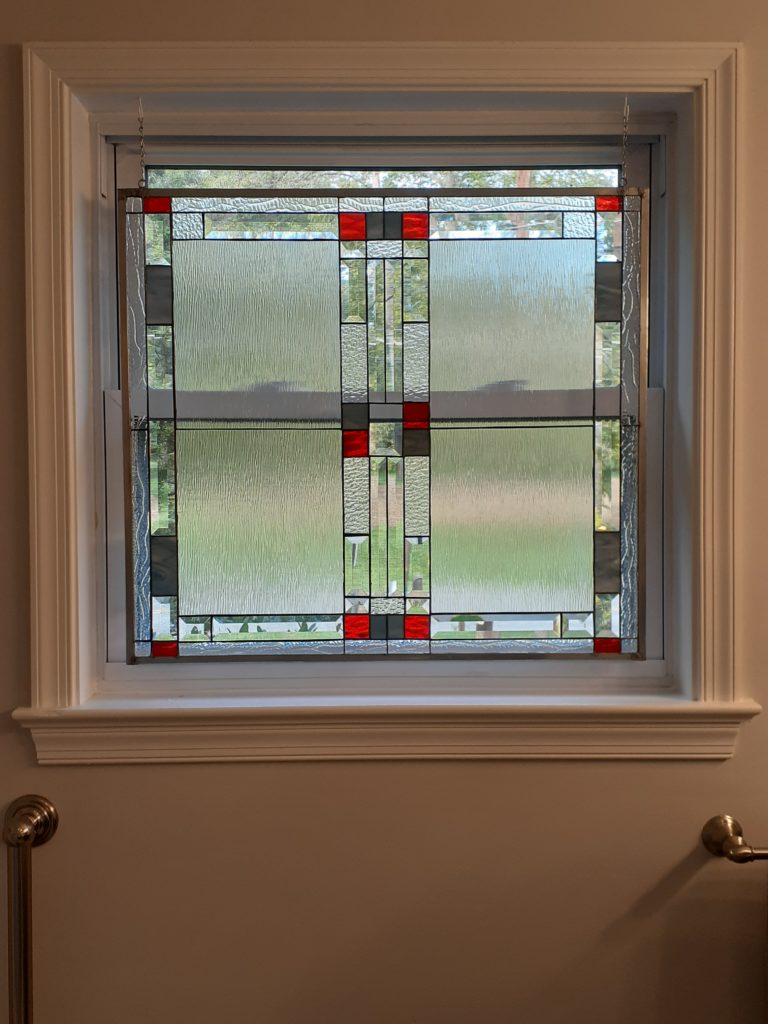 Mission Style Clear and beveled Stained Glass Window Installed ina Master Bathroom